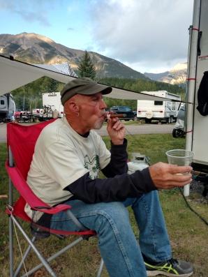 Enjoying a stogy a Laphroaig at camp