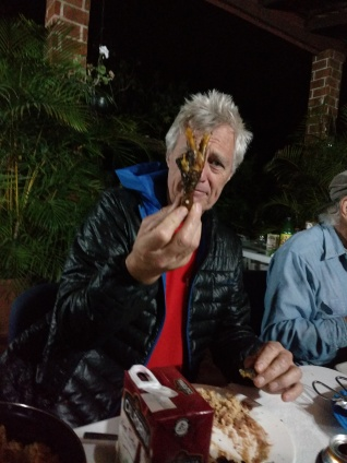 Curt about to munch a chicken foot. Tastes like Roo.