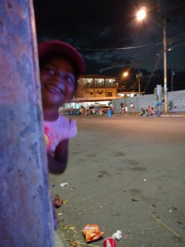 Little girl playing peek-a-boo.